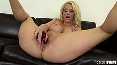 Busty blonde MILF, Courtney Taylor masturbates in a solo show