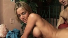 Gracious slender bitch with fake jugs gets wet after cock-sucking